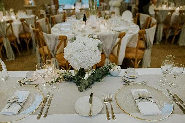 Cross back wedding chairs look stunning