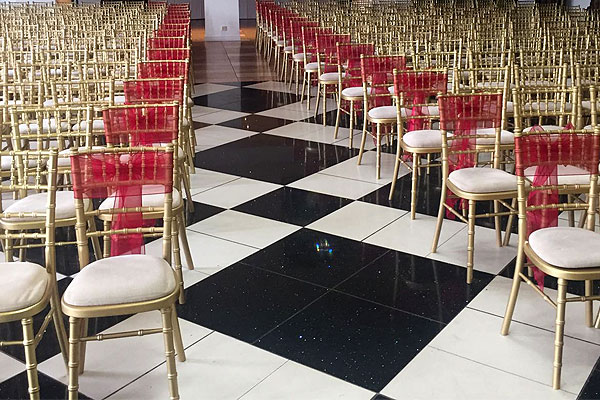 Gold Chiavari wedding chairs on location