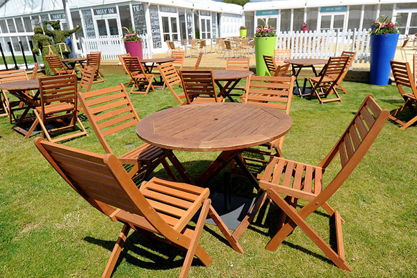 Hardwood furniture hire for lawned areas